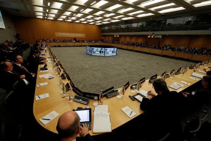 © Reuters. L'OCDE PRÉVOIT UNE AMÉLIORATION DES PERSPECTIVES ÉCONOMIQUES MONDIALES